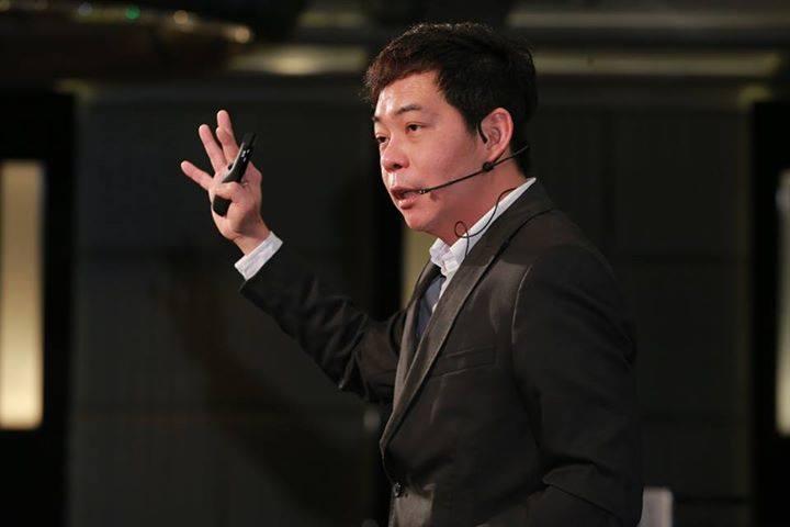 Ewen Chia speaking at a coaching seminar